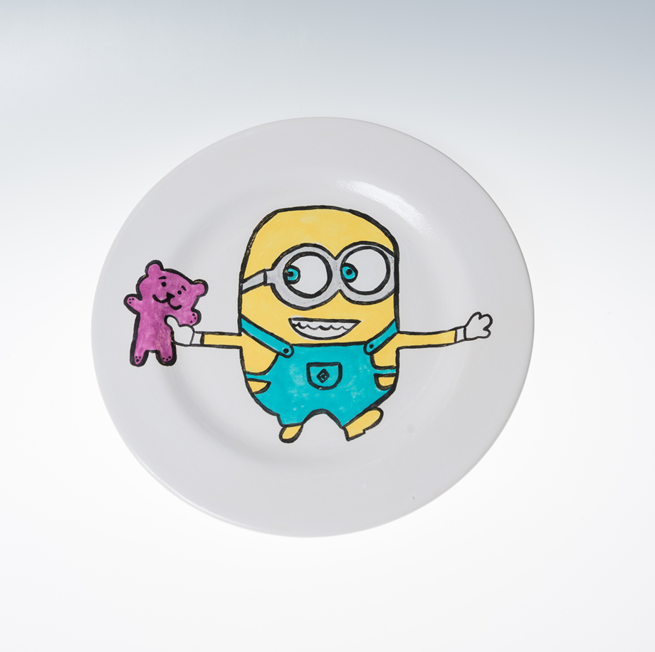A handpainted minion plate at Hullabaloo party