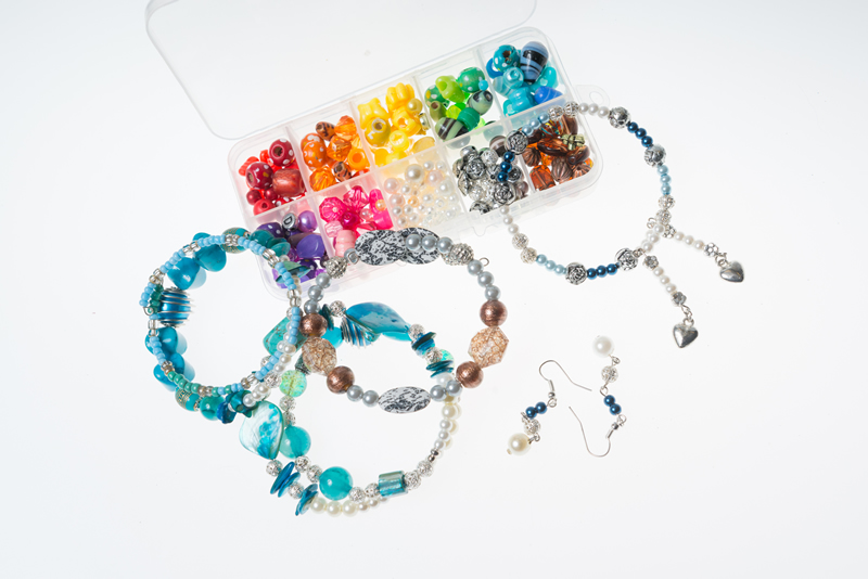 Handmade items of jewellery and colourful beads