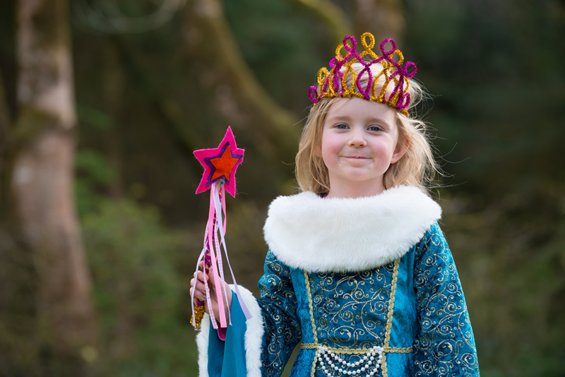Girl dressed up as fairy princess with handmade wand and tiara at Hullabaloo party