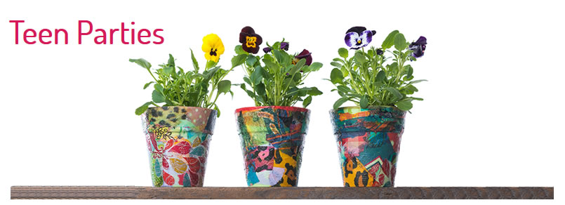 3 decoupaged flower pots with pansies in them