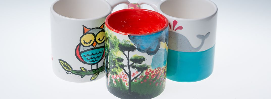 3 handpainted ceramic mugs at Hullabaloo workshop