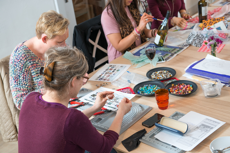 Adult party making jewellery with Hullabaloo & decoupaging