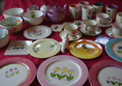 Tulip themed dinner set done at a Hullabaloo pottery painting hen party
