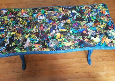 Upcycled old table by decoupaging photos from an out of date calendar