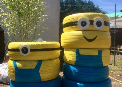 Upcycled old tyres made into minion planters