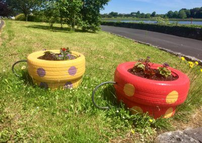 Upcycled old tyres made into tea cup planters