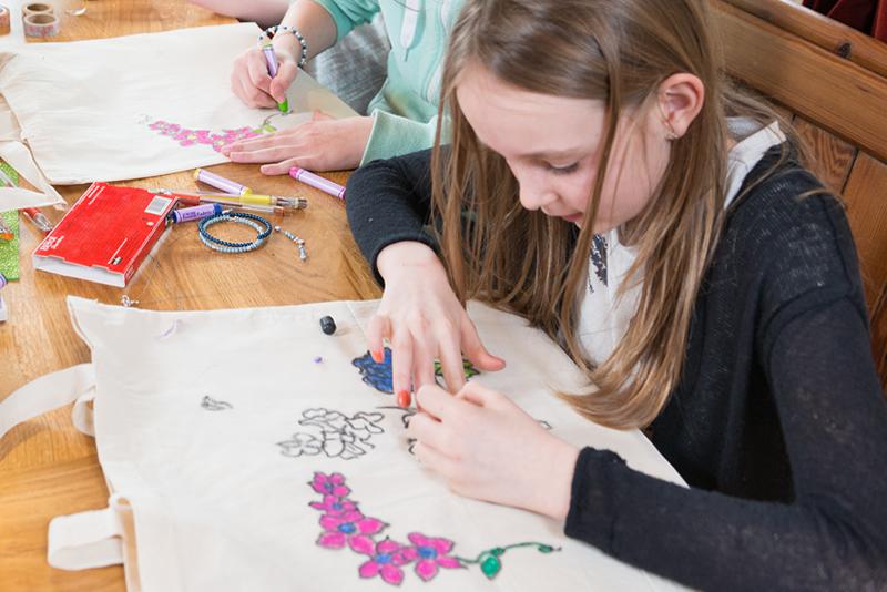 Girl designing her own handmade canvas bag