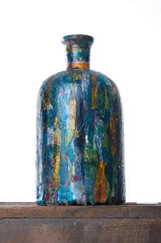 Decoupaged bottles, stone and pot with Hullabaloo