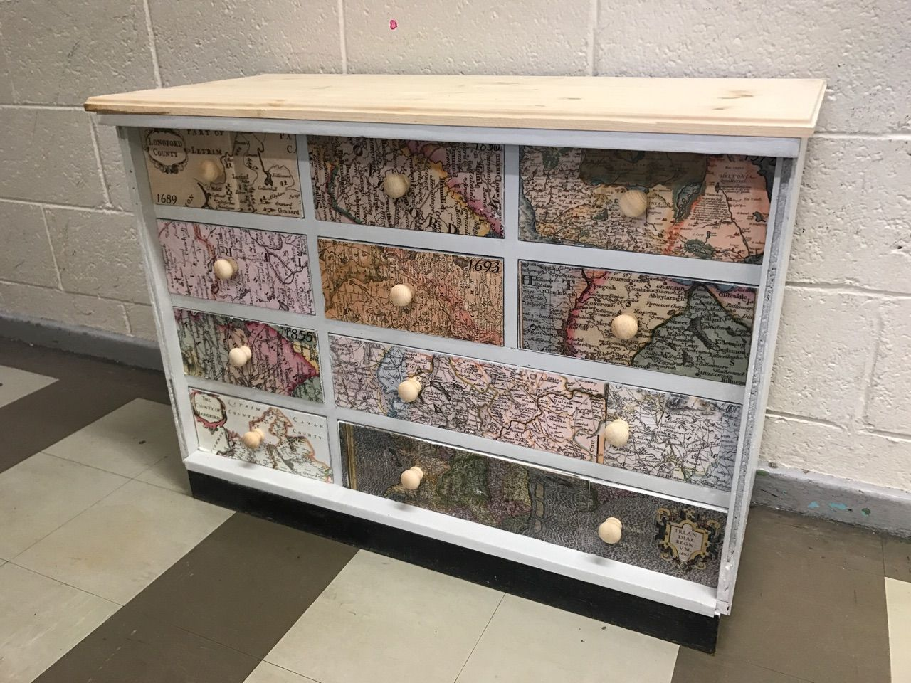 Upcycled furniture using decoupage technique and old maps
