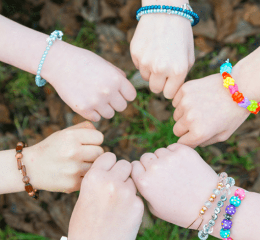 kids-hands-wearing-handmade-bracelets